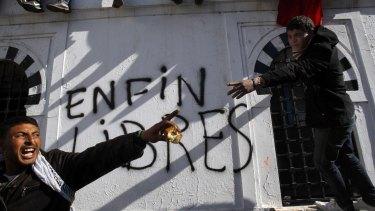 "Graffiti reading ""Free at last"" in Tunis in 2011."