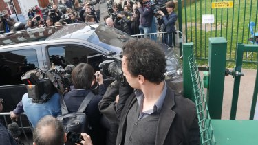 The Le Pen convoy arrives to vote.