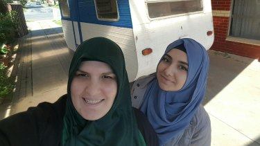 Betul Tuna (left) and her business partner Suzan Yilmaz with their 'caravan cafe', which they hope will become a meeting place in Shepparton for people of different faiths.