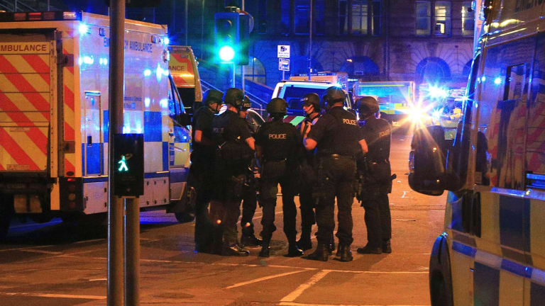 Armed police gather at Manchester Arena after reports of an explosion at the venue during an Ariana Grande gig in Manchester.