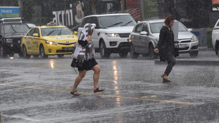 Melburnians making a dash for it as the skies open.