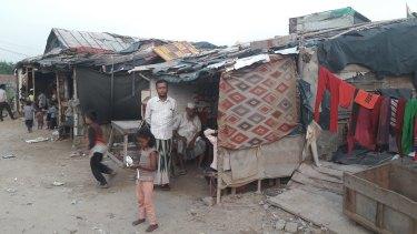 Rohingya Mohammed Salimullah outside his market stall.