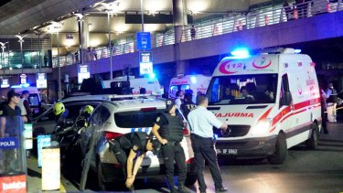 Turkish security officers and ambulances gather outside Istanbul Ataturk Airport.