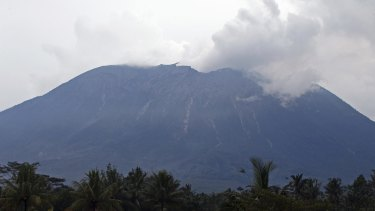 Mount Agung spews volcanic ash into the air at Selat village.