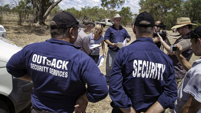 A security team evicts Claire (striped shirt) and Chris (blue shirt) Priestley from a north-west NSW property owned by their family since 1969.