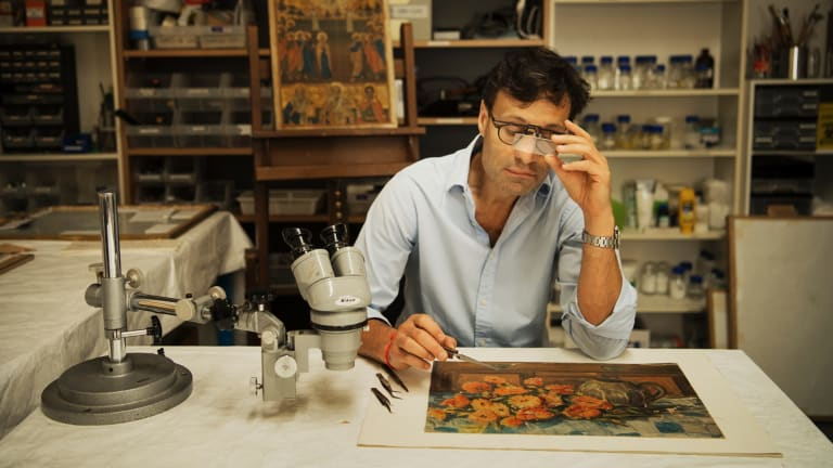 David Stein is restoring the painting by renowned Australian artist Margaret Olley.