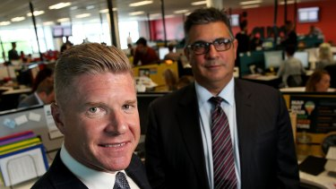 Andrew Demetriou, right, with John Wall, chief executive of Acquire Learning, which has been accused of taking advantage of vulnerable consumers.