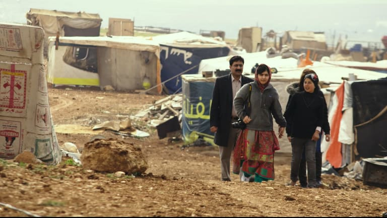 Malala Yousafzai visits a Syrian refugee camp in Jordan in 2014.