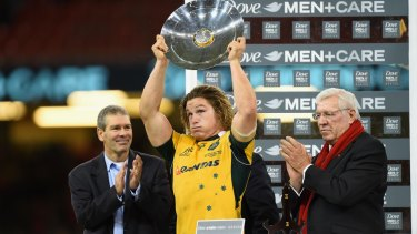 Relieved: Michael Hooper holds up the James Bevan Trophy.