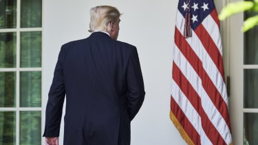 US President Donald Trump turns to leave after announcing the US would withdraw from the Paris climate accord.