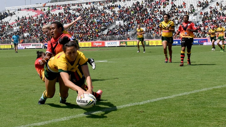 Over the line: Corban McGregor scores for the Jillaroos in Port Moresby.