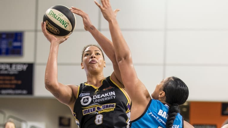 Centred: Melbourne's Liz Cambage launches a shot over Canberra's Mistie Bass.