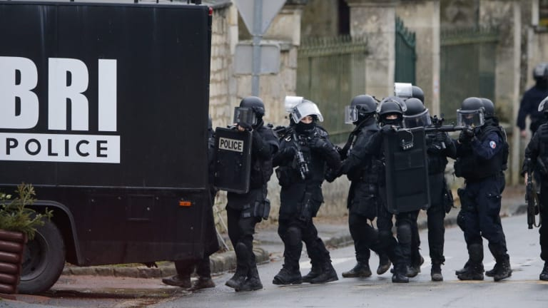 French police descend on the village of Longpont.