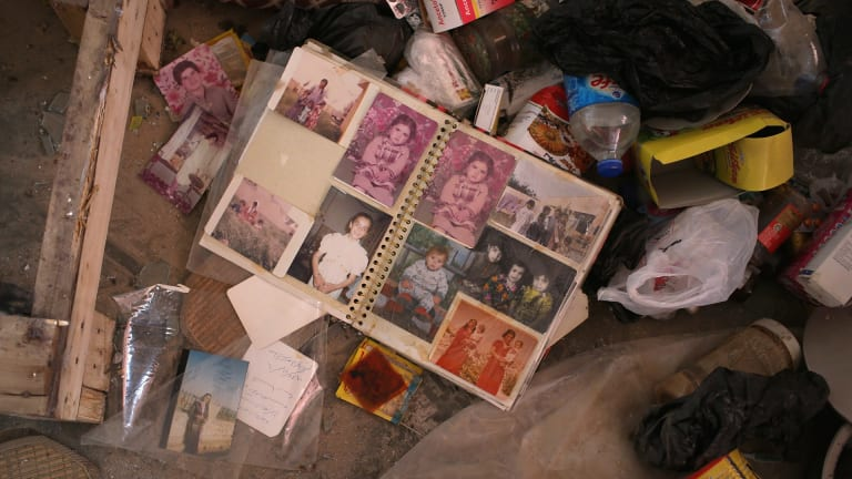 A family photo album in the rubble of a home in Sinjar.