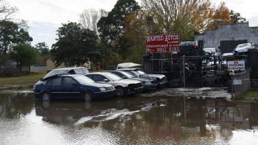 Cars trapped in floodwaters on Newbridge Road, Milperra.