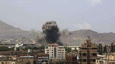 Smoke rises after a Saudi-led airstrike hits an army base in Sanaa, Yemen on September 14.