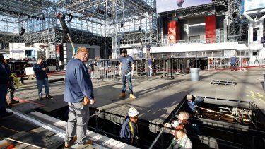 Workers prepare the Manhattan stage Democratic presidential candidate Hillary Clinton will use on election night.