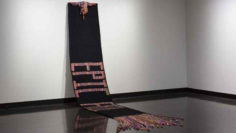 Installation view of Alice Lang's large woollen work Epic Fail at the Counihan Gallery as part of Is This Thing On?