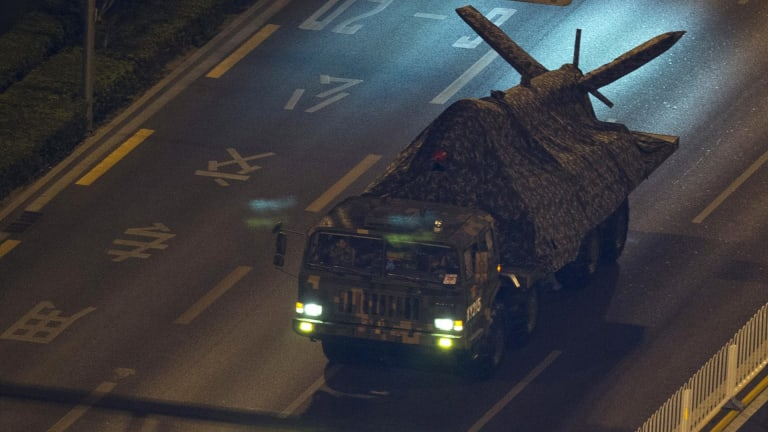A Chinese military truck carries what appears to be a drone during rehearsals.