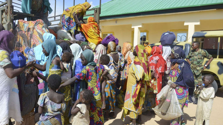 Women and children rescued by Nigerian soldiers from Boko Haram extremists in the north-east of Nigeria arrive at the military office in Maiduguri.