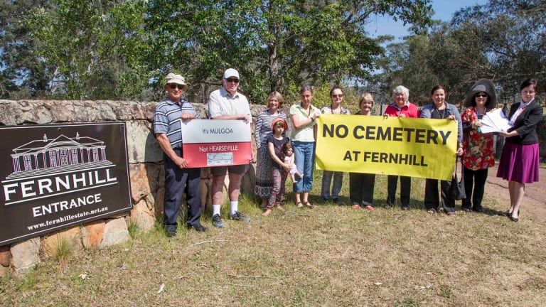 Minister Tanya Davies, the local member for Mulgoa (pictured far right), with local residents at the entrance to Fernhill estate.