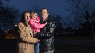 Donna and Mike Hettinger with their daughter Phoebe, four, who was attaked by a dog last year.