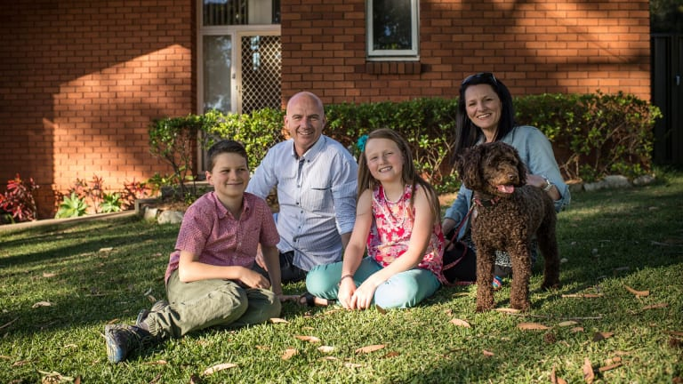 Starting Christmas shopping early pays off for Santina Gambrill, shown with her husband Aaron and children Jaden and Tara and Ruby the dog.