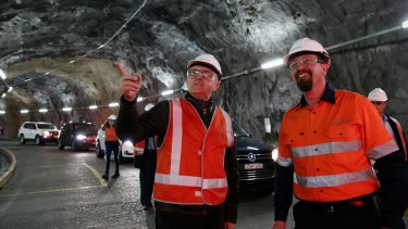 Prime Minister Malcolm Turnbull with Upper Tumut Area Manager Kent Allen, during his tour of the Snowy Hydro Tumut 2 power station on Monday.