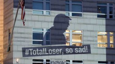 A Greenpeace image showing the shadow of US President Donald Trump is projected onto the facade of the US embassy in Berlin on Friday.