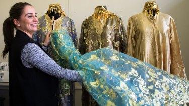 Deena Yako with traditional Iraqi clothing.