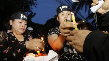 Human rights activists light candles  at Monday's protest in Phnom Penh. Human Rights Watch and Cambodian human rights groups have decried increasing persecution of dissent in the country.