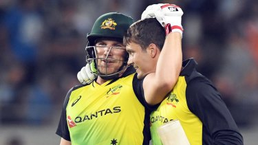 Big finish: Aaron Finch and Alex Carey celebrate the winning runs.