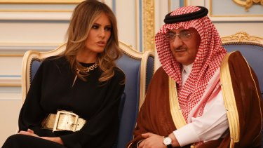 Melania Trump talks with Saudi Crown Prince Muhammad bin Nayef. Her appearance was no different to Michelle Obama's two years ago.