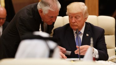 US Secretary of State Rex Tillerson hands a note to US President Donald Trump during a meeting with leaders at the Gulf Cooperation Council Summit in Riyadh on Sunday.