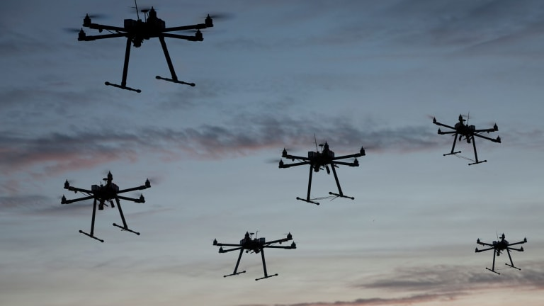 Hexacopter drones flying in the evening.