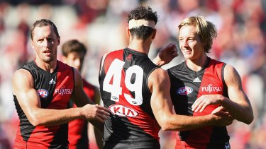 James Kelly (left) and Matt Dea (centre) are staying at the Bombers.
