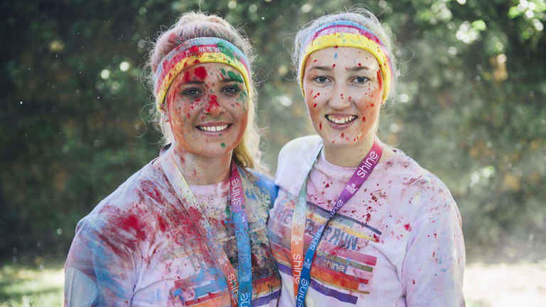 Happy runners from the 2016 Color Run in Canberra.