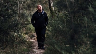 Ricardo Lonza, founder of a Facebook group dedicated to saving wildife and bushland of Campbelltown, surveys the treetops of St. Helens park for koalas.
