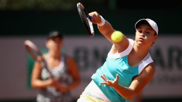 Ashley Barty and Casey Dellacqua (background) at the French Open.
