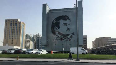 The face of the Emir on a building in Doha, Qatar. Qatari are showing solidarity with the government for withstanding the pressure of the blockade.