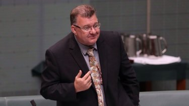 """Liberal MP Craig Kelly handed out flyers containing his wish """"to contribute to a Coalition government under Tony Abbott:."""