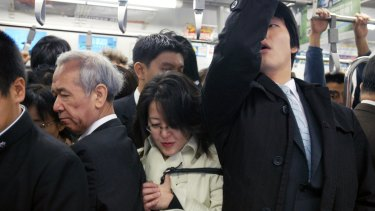The big squeeze on a Tokyo subway train during morning peak hour.