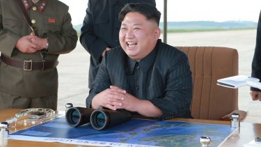 Kim Jong Un attends what was said to be the test launch of an intermediate range Hwasong-12 missile at an undisclosed location in North Korea, in September.