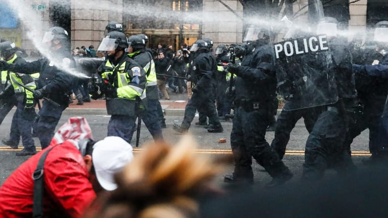 Protests at the Trump inauguration. US President Donald Trump has reportedly told UK Prime Minister Theresa May that he will not visit the UK if there is a risk of protests.