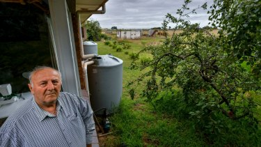 """George Gigas, who lives next to the proposed jail site says """"there's going to be a lot of trouble over this""""."""