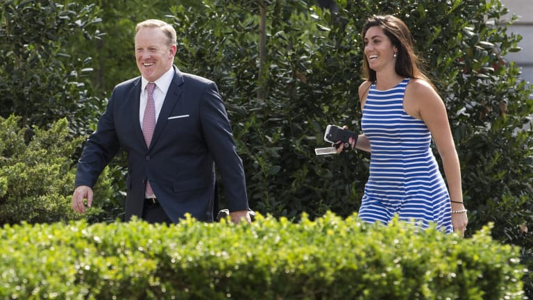 Sean Spicer, outgoing White House press secretary, left, smiles while walking to the West Wing with Vanessa Morrone, advisor to the White House Press Secretary on Thursday.