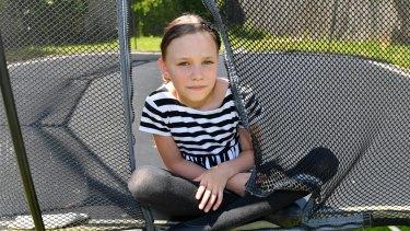 Orla Morrison-Brown, 9, broke both bones in her right arm getting off a trampoline.
