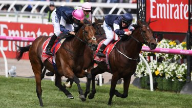 Corey Brown (left) reacts after Rekindling beat Johannes Vermeer (right) to win the Melbourne Cup.