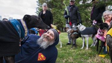 Darren Bulmer with his rescue greyhound Bentley.