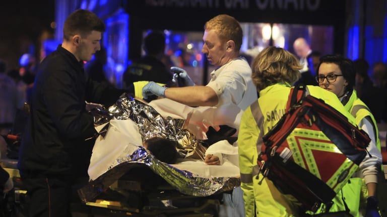 Emergency workers in Paris helping the injured in the Bataclan theatre.
